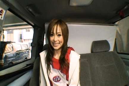 Racing Queen Miina Yoshihara Models an STP Logo on Her Chest