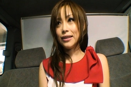 Racing Queen Miina Yoshihara Models an STP Logo on Her Chest
