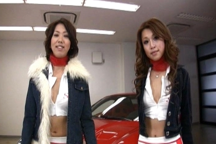 Two Racing Queens Take Turns Posing and showing Pussy by the Car