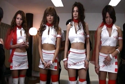 Four Hot and Horny Racing Queens Pose in Front of a Ruby Red Racing Car